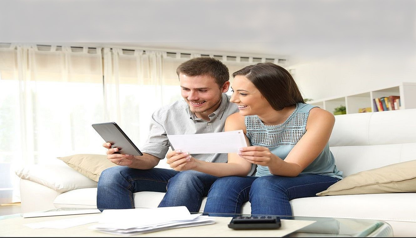 Smiling couple looking at a tablet image